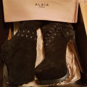ALAIA SHEARLING BOOTIES